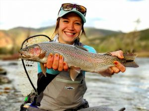 rainbow trout caught by woman fly fishing in colorado
