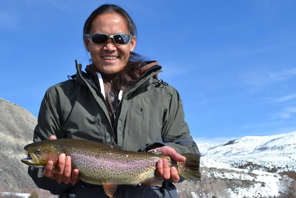 11224-Eagle river Vail-Woman smiling with big rainbow trout