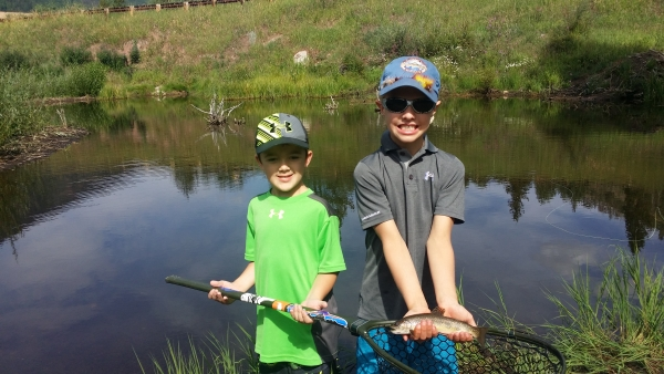 Brook trout - children fly fishing