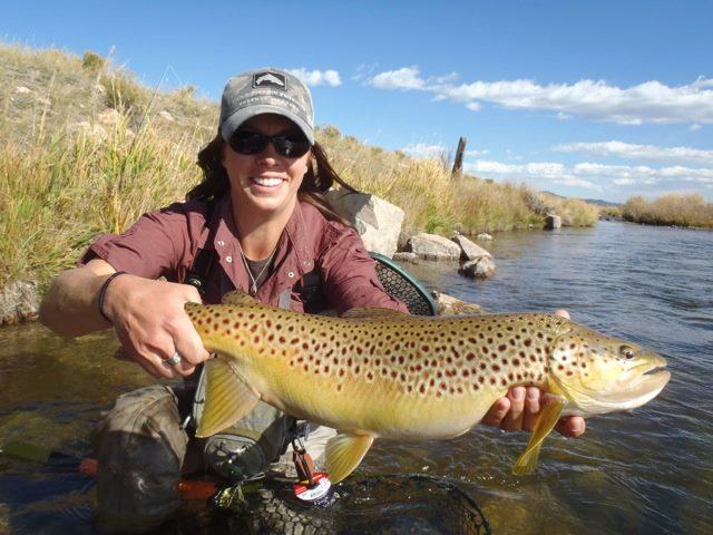 16380-Dream Stream Denver-10/20: 2013-woman smiling with fish