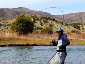 woman fly fishing in colorado