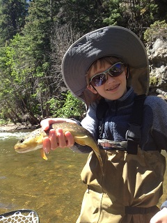 Gore Creek Vail-Children smiling with Fish